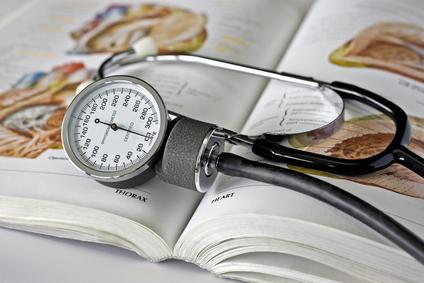 sphygmomanometer over book
